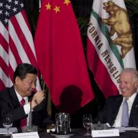 Xi's visit to U.S. comes at time of tension over hacking, China's maritime actions