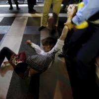 Trio held for allegedly roughing up riot police at rally against security bills outside Diet