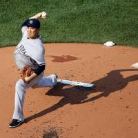 Tanaka picks up 11th victory