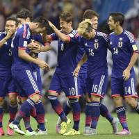 Japan overcomes slow start to put away Cambodia