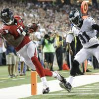 Jones leads Falcons past Eagles in Quinn's debut