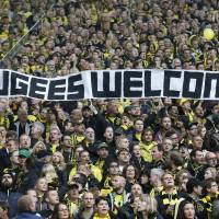 German clubs reach out to refugees