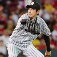 Nomi, Fukudome carry Tigers past Carp