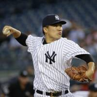 Tanaka fans 10 in impressive no-decision against O's
