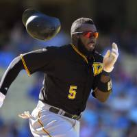 Dominant Cole lifts Pirates to victory