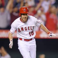 Angels boost playoff hopes
