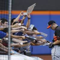 Marlins ride offense, good pitching to victory over Mets