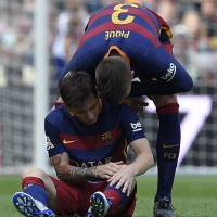 Messi sidelined with knee injury