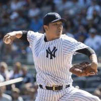Tanaka leads Yankees to win over Blue Jays