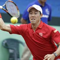 Japan keeps Davis Cup place after rallying to sink Colombia