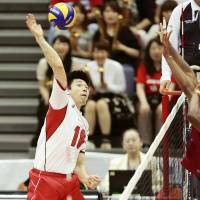 Japan volleyball squad holds off Venezuela