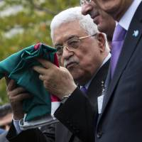 Abbas hoists first Palestinian flag at U.N., dumps Israeli accords, presses for statehood
