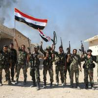 Assad-allied troops score gains, aided by Russian airstrikes