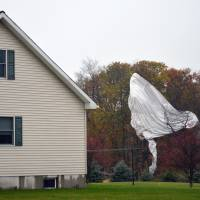 Pennsylvania police fire shotguns to deflate army blimp stuck in ravine