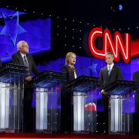 Clinton enters debate fray defending shift on trade pact, gay marriage, hits 'socialist' Sanders on guns