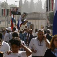 Russian Embassy in Damascus shelled during rally; Iranian fighters seen pouring into Syria to fight for Assad