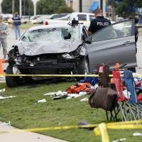 Driver plows into crowd at homecoming parade in Oklahoma; four dead, including 2-year-old
