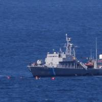 Seven migrants killed when their boat, reportedly fleeing, collides with Greek coast guard vessel