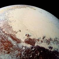 Stargazers stunned by Pluto ice, terrain, surface's color extravaganza