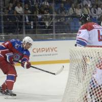Putin marks 63rd birthday on ice with NHL stars, West-sanctioned tycoons