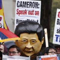 After state visit Xi leaves U.K. with call for it to remain a part of EU