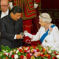 U.K. rolls out red carpet for China's Xi on contentious visit