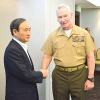 Suga makes rare trip to Guam to back U.S. Marine transfer plan