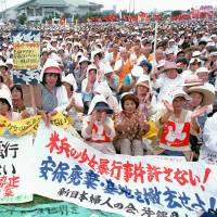 Former Okinawa governor speaks of island burden 20 years after rally over girl's rape
