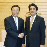 Abe, China's Yang vow to promote dialogue