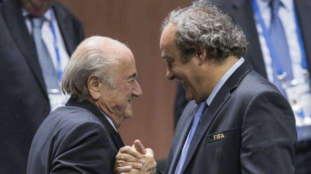 FIFA hands boss Blatter, UEFA chief Platini 90-day suspensions
