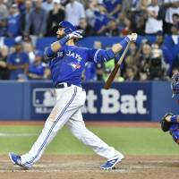 Blue Jays advance after wild win over Rangers