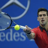 Djokovic continues pursuit of Nadal's unbeaten record at a tournament