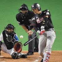 Marines pounce on Fighters' Otani in Game 1 rout