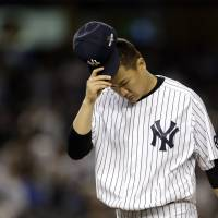 Tanaka falls in playoff debut