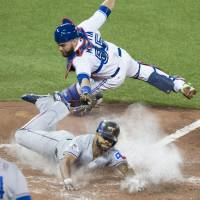 Astros take opener from Royals; Rangers top Blue Jays