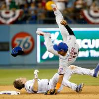 Utley slide riles Mets in Dodgers' win