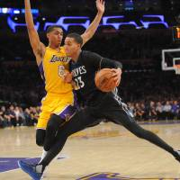 T-Wolves rally past Lakers in first game since Saunders' death