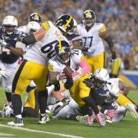 Bell's TD on last play gives Steelers victory
