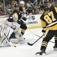 Improving Penguins find way past Sabres