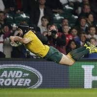 Australia knocks host England out of RWC