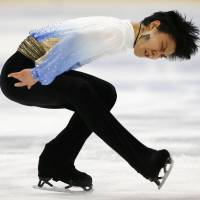 Hanyu takes lead in season debut