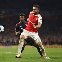 Arsenal's Champions League hopes still alive after victory