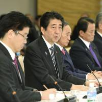 Abe seeks measures to prevent workers from quitting jobs to care for family