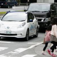 Nissan demonstrates its self-driving car on the streets of Tokyo