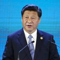 China's Xi tells neighbors that rival trade pacts risk 'fragmentation' of region