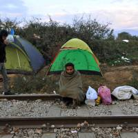 Ban blasts Balkan border curbs, 'profiling' of refugees; Greece arrivals ebb