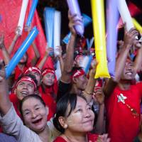 Suu Kyi's party seen sweeping Myanmar's historic vote; icon vows to rule 'above president'