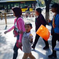 China says one-child policy remains in effect for now; searches for pregnancy tips soar