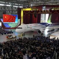 China showcases aerospace ambitions with first homegrown passenger plane