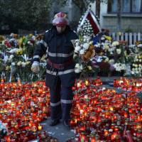 Tempers flare as Bucharest nightclub fire death toll hits 30, forecast to possibly double
